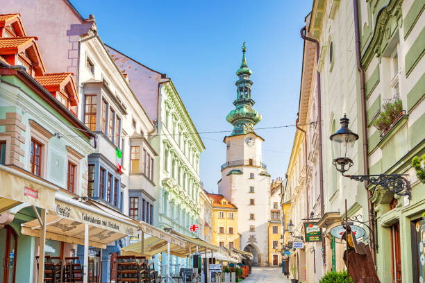 Stock photograph of an alley with stores and restaurants in old town Bratislava, Slovakia.