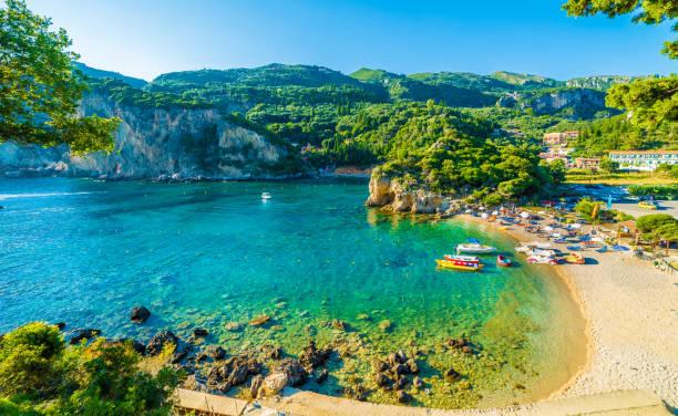 Beautiful beach and boat in Paleokastritsa, Corfu island, Greece