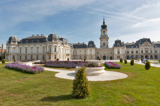Unrecognized people visit Festetics Palace. The building now houses the Helikon Palace Museum. Keszthely is located on the western shore of Lake Balaton.