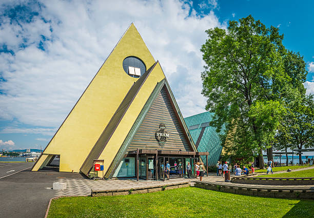 Oslo, Norway - 11th July 2014: Tourists visiting the famous pyramid of the Fram Museum of polar exploration on the Bygdoy peninsula of Oslo, Norway. Composite panoramic image created from five contemporaneous sequential photographs.