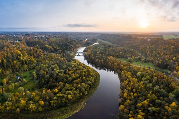 River Gauja in autumn next to Sigulda, Latvia. Photo taken on from a drone