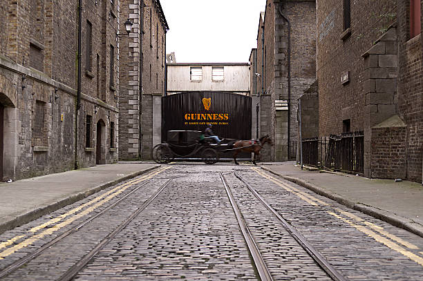 Dublin, Ireland - December 14, 2008: Carriage in transit in front of the entrance gate at the Guinness Storehouse on December 14, 2008 in Dublin, Ireland. The Guinness Storehouse is a popular tourist attraction with 1,087,209 visitors in 2012.