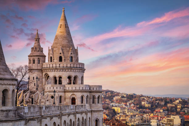 Colorful twilight over the famous historical main neo-romanesque Lookout Tower of Fishermen's Bastion - Halaszbastya - built between 1895-1902 uphill on the Buda Bank of the Danube River. Várkerület District, Budapest. Budapest, Hungary, Eastern Europe
