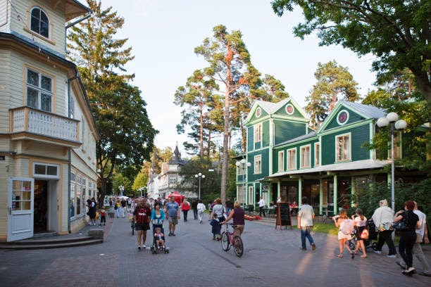 Jurmala, Latvia - July 16, 2011: Russian tourists walking down the Jomas street in Jurmalaian . Jomas street is one of the oldest and central streets of Jurmala with restaurants, summer terraces, hotels and cafés