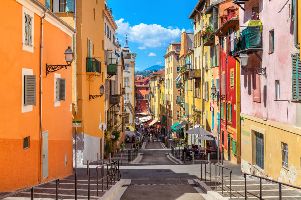 Nice: Narrow street in old tourist part of Nice - fifth most populous city and one of the most visited cities in France, receiving 4 million tourists every year.