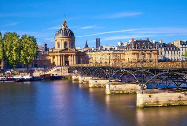 Pont des Arts leading towards Institut de France, Paris, France. The bridge is a popular place for couples in Europe.