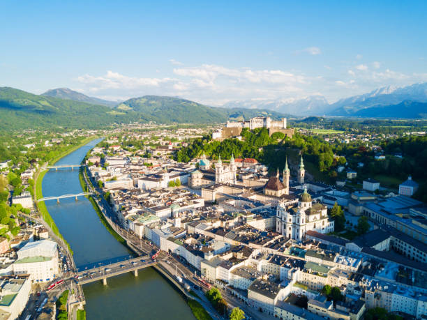 """Salzburg city centre and Salzach river aerial panoramic view, Austria. Salzburg (literally """"Salt Fortress or Salt Castle"""") is the fourth largest city in Austria."""