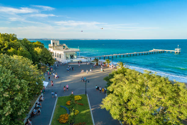 Stunning aerial drone view over the sea garden in Burgas, Bulgaria ultra wide shot. The scene is situated outdoors near sunset in Burgas, Bulgaria on the Black Sea shores. The photo is taken with DJI Phantom 4 Pro drone.