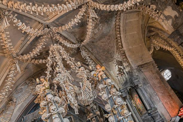 Prague, Czech Republic - Sept 04, 2019: Arranged Human Skulls and Bones in Kostnice Church in Kutna Hora, Czech Republic. Ossuary decoration of human bones and skulls