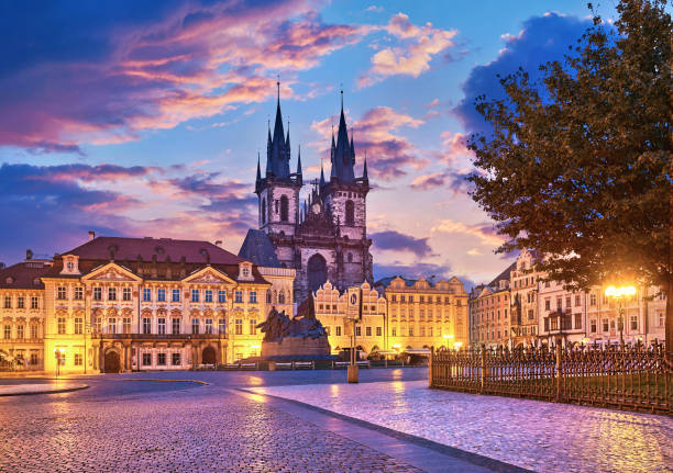Church of our lady before tyn on Old Town Square Prague Czech republic with red roof sunset sky.