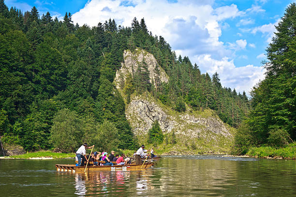 """""""Szczawnica, Poland - August 17, 2011: The river tour across Dunajec gorge. Raftmens and turists sitting on special rafts and admiring beauty of Pieniaski National Park in unusual and fascinating way. The river tour lasts from 2 to 3 hours."""""""