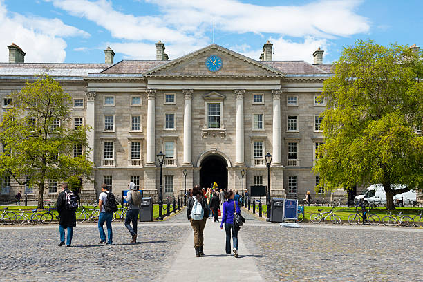 Dublin, Ireland - June 13, 2013: People walk on the campus of Trinity College, which was founded by Queen Elizabeth 1 in 1592.