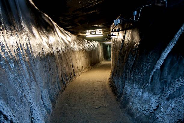Turda, Romania. 02 July, 2015: Long tunnel in a salt mine in Turda